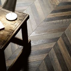Just arrived, our Faux Bois Chestnut Chevron Porcelain Tile - all the beauty and charm of antiqued wood with the durability and everyday ease of porcelain tile #tiletuesday #walkerzanger