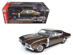 1968 Oldsmobile Cutlass 442 Hardtop Cinnamon Bronze Limited Edition to 1002pcs 1/18 Diecast Model Car by Autoworld - Brand new 1:18 scale diecast car model of 1968 Oldsmobile Cutlass 442 Hardtop Cinnamon Bronze Limited Edition to 1002pcs die cast car model by Autoworld. Brand new box. Rubber tires. Made of diecast metal. Detailed interior, exterior. Detailed Engine. Steerable Front Wheels. Accurate Interior. Opening Doors & Hood. Dimensions approximately L-10, W-4.5, H-3.25 inches. The Olds…