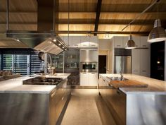 Look at all that prep space! Industrial modern chef kitchen. I would never leave.