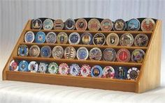 Solid hardwood display rack of beautiful design and construction. A great way to display your coins, casino chips, military challenge coins, or service medals. This unique displays holds approximately