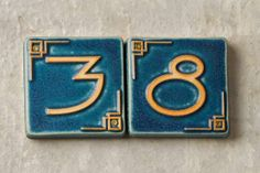 These hand-pressed house number tiles feature a Craftsman-style motif and a rich matte glaze. Cost: $30 per tile from Pewabic Pottery. | Photo: Andrew McCaul | thisoldhouse.com