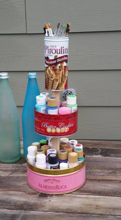 recycled treat tins into handy paint caddy
