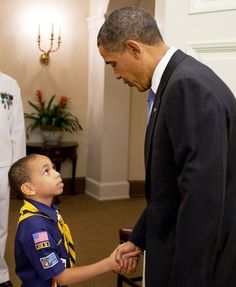 President Barack Obama Shaking Hands With a Young Cub Scout. (So sweet.)
