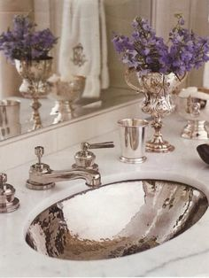 Hammered sink and gorgeous silver decor.
