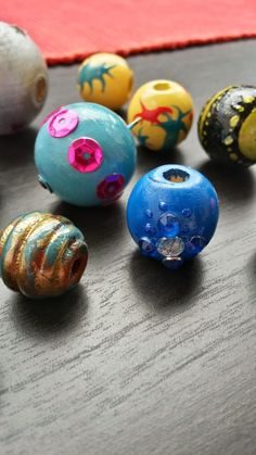 Painted wooden beads using acrylic paint and nail polish.