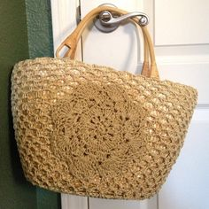 NWOT beach bag. B1G150%off until 10/1/16 NWOT since it had no tags when bought, not a brand name. Wooden handles, inside is lined and has a small pocket, outside is tiered mat to make the purse and crocheted cover and design looks like it's made of raffia. Perfect for the beach! No trades. No PayPal. Comes from a smoke-free and pet-free home. B1G150%off until 10/1/16 Bags