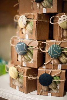 Fabric covered buttons for the bow centers. Dresses up simple packaging
