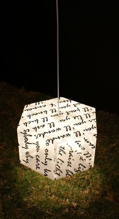 "This origami light includes excepts from Allen Ginsberg's poem, ""When the Light Appears"""
