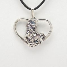 Sterling Silver Tibetan Spaniel Pendant with Silver Chain by Donna Pizarro from the Animal Whimsey Collection of Dog Jewelry by DonnaPizarroDesigns on Etsy