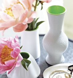 Fun Painted Vases  For a small dose of neon, glaze the insides of white ceramic vases with lime green paint.   This unexpected hit of colour will give an ordinary white vase a fresh new look.