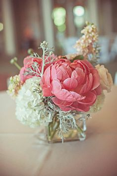 I would love to mix tables up with some flowers as the focus with small candles and others with candles as focus and small flower arrangements like this!!