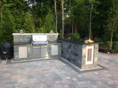 Limestone panels used to accent built in grill