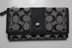 Coach Signature Checkbook Wallet Coach. $198.00