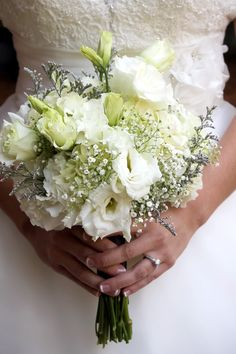 white lisianthus bouquet - also has baby's breath and white hydrangeas