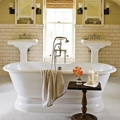 There are thousands of amazing tile options available, but some staples will always be classics. Created from unused attic space, this master bath glistens with classic white subway and reproduction hexagonal floor tile. | SouthernLiving.com