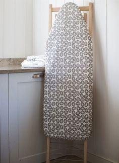 A stylish large ironing board cover in a grey design