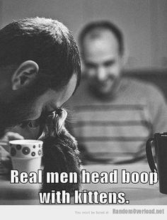 A real man knows how to pet a cat.   28 Ways To Spot A Real Man