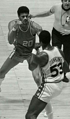 Maurice Lucas and Daryle Dawkins in a boxing match.