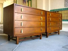 A Gorgeous Pair of Mid 20th Century Walnut Bedside chests by Cal Mode Furniture | From a unique collection of antique and modern cabinets at http://www.1stdibs.com/furniture/storage-case-pieces/cabinets/