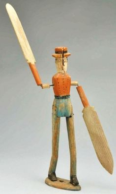 Lot: 1128: Wooden Primitive Whirligig., Lot Number: 1128, Starting Bid: $50, Auctioneer: Dan Morphy Auctions, Auction: MORPHY AUCTIONS Sat, Feb. 25, 2012 Auction, Date: February 25th, 2012 BRST