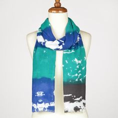Love the bright colors of this blue and teal scarf