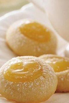 """Even lemon doubters will be addicted to these adorable homemade lemon cookies. The tangy filling is oh-so-yummy, and it pairs perfectly with the easy vanilla cookies. One of our most popular lemon recipes! """"Anyone who loves lemon will love the tangy center,"""" says Betty member MaryBBell. """"I topped them off with a few strands of coconut and they were just yummy! Working making a family tradition!"""":"""