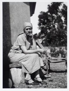 The Bloomsbury Group: Vanessa Bell sitting outside the drawing room in the garden of Charleston, the home she shared with Duncan Grant.