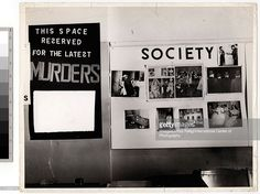 View of a pair of wall-mounted collages at Weegee's one man exhibition, 'Murder is My Business,' held at the New York Photo League, New York, New York, late 1941. The one on the right, 'Society,' features a series of Weegee's photographs, while the one on the left, under the heading 'This Space Reserved for the Latest Murders,' is intentionally void of images. (Photo by Weegee (Arthur Fellig) / International Center of Photography / Getty Images)