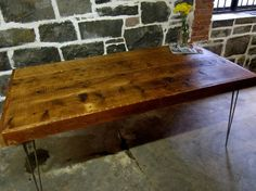 Reclaimed wood and recycled steel joist table...love
