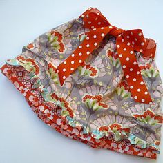 Super cute skirt!!! Even has a scallop around the top skirt and belt loops :D