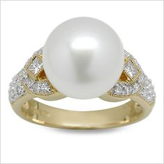 Toci a White South Sea Cultured Pearl Ring _ This exotic and fashionable 18K yellow gold ring features a perfectly round, perfectly clean AAA quality South Sea cultured pearl set with diamonds. Retail Price: $1,400.00 Our Price: $950.00