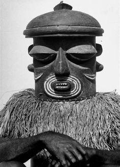 Africa | A man wearing a mask for a ritual in the Belgian Congo.  1947 | ©Eliot Elisofon