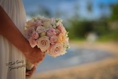 Beautiful tropical bouquet from Maui bride in Hawai'i. Photo by www.TadCraigPhotography.com