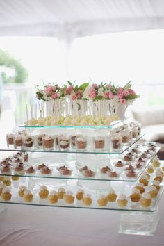 You can achieve this elegant look with your bite sized desserts by using a couple glass cake stands on top of each other.  May not be as grand, but the effect will be similar.