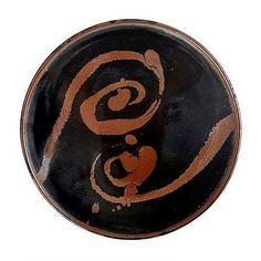 Shoji Hamada (1894-1978)  |  Tenmoku plate with wax-resist pattern.