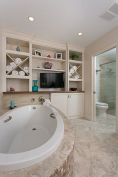 Bathroom design with whirlpool tub, separate shower and TV. Photo courtesy of Momentum Construction and Gregg Willett Photography