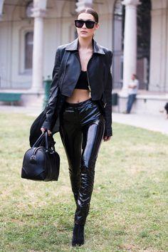 Bella Hadid's best street style looks. Black bralette+black vinyl pants+black boots+black short leather jacket+black handbag+sunglasses. Fall Outfit 2016