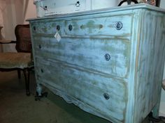 This beautiful distressed chest is painted with sage green and french blue. Farmhousepaint.com