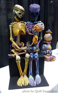 Family Life by Susan Else.  Fabric collaged skeletons.  2015 PIQF; photo by Quilt Inspiration.