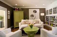 Green/white/brown living room. Swap brown walls for grey, white seating for khaki (that's the color I have) and white furniture for dark brown.