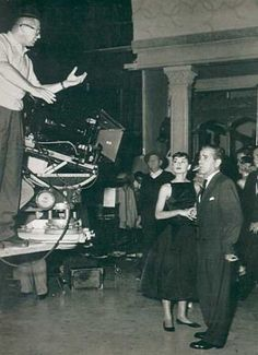 Audrey and Humphrey Bogart being directed on the set of Sabrina by William Wilder.
