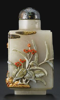 AN EMBELLISHED CELADON JADE SNUFF BOTTLE BOTTLE: QING DYNASTY, 1770-1850 EMBELLISHMENT: TSUDA FAMILY, KYOTO, JAPAN, 1900-1941 of rectangular shape with indented edges, embellished with hardstone, ivory and mother-of-pearl to form a scene of begonia, millet and other flowering plants with a long-tailed bird flying overhead, the details accented with lacquer and pigments