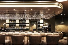 """Monty's Wine Bar, """"This is a contemporary interior that has classical elements with a minimalist interior, clean fresh walls with an echo of the back bar and slightly retro lighting styles. The clients, Guzaliya and Nurik gave me complete free reign on this design with a very tight budget, and I am delighted with this interior."""" - Steve Howie. www.stevehowie.co.uk"""
