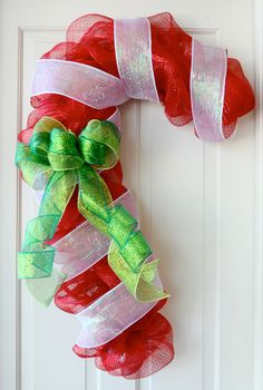 tutorial for mesh candy cane wreath - so cute!! could use a wire coat hanger, shaped like a candy cane instead of the purchased frame