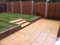 Back garden with striped lawn and paved slabs. Make your home design dreams come true. Read reviews of 1000s of trusted tradesmen across the UK and get free quotes on MyBuilder.com.
