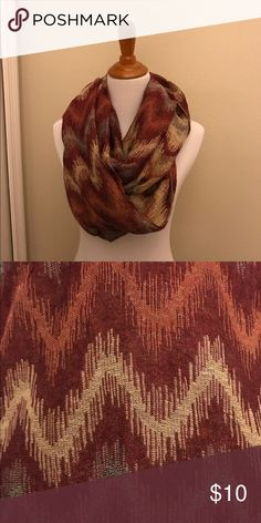 Beautiful chevron infinity scarf. Red, gold, burnt orange. This scarf is really beautiful! No tag attached, but I believe this is Acrylic. I have washed and dried this, and it has kept its shape. This has been my favorite scarf, but since moving to the sunshine state, I have no use for it. Time for this scarf a new home! Bundle and save! Accessories Scarves & Wraps