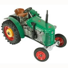 """kovap Zetor 25A tractor -3 forward gears and one reverse gear. clockwork motor wound via one of the large wheels . fitted with a brake.  All the tractors are in 1/25"""" scale. the tractor is a very good likeness to the real thing and has the actual type of tractor name on the body work. Kovap have recently celebrated there 55 years of being in business behind the Iron curtain and as a company in the Czech Republic."""