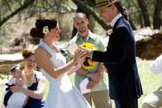 match headpiece flowers with groom boutonniere. nice touch.