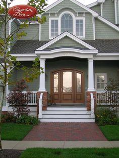 Door arch matches shape on porch. Privacy and light! Exterior Doors, Entry Doors, Front Doors, Reeded Glass, Custom Wood Doors, Sliding Glass Door, Gazebo, Porch, Outdoor Structures