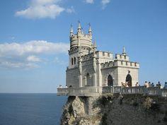 A Russian castle perched precariously over the Crimean Sea.